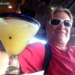 Blogger selfie with a margarita at a Florida beach bar