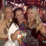 Bourbon Street bar balcony girls